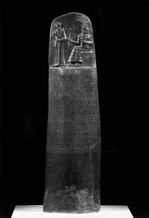 The Code of Hammurabi (1792-1750 BCE), 282 laws. Hammurabi standing before the sun-god Shamash. Engraved black basalt stele (1st half 19th BCE, 1st Babylonian Dynasty). Originally from Babylon, found at Susa, Iran. Height 225 cm