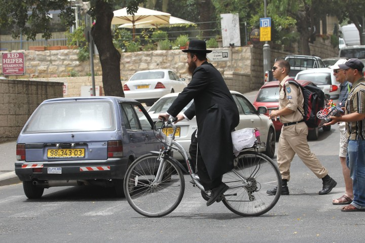 ultra orthodox jewish man riding bicycle