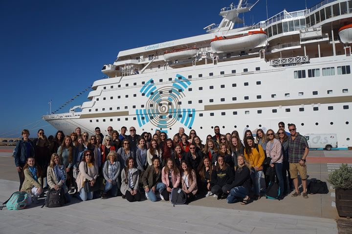 group in front of cruise ship