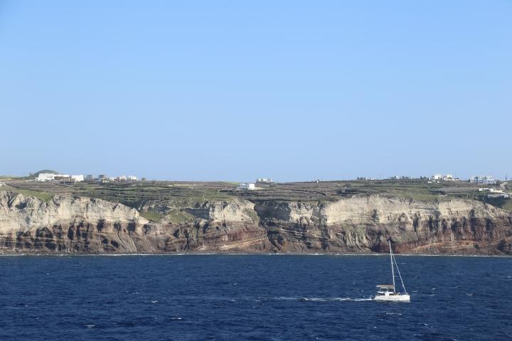 Santorini coastline with sailboat